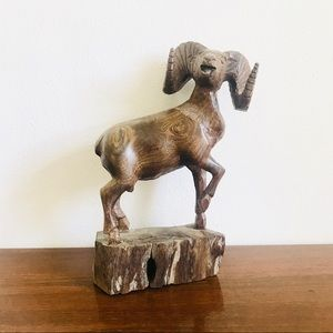 Large carved ironwood ram sculpture